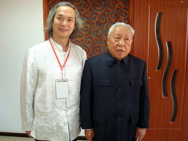 黄明大师与全国政协副主席杨汝岱交流